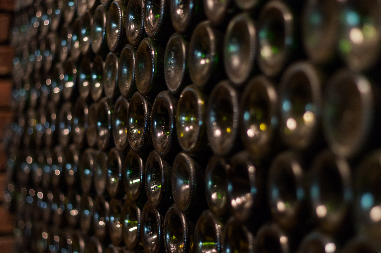 image of wine bottles neatly stacked